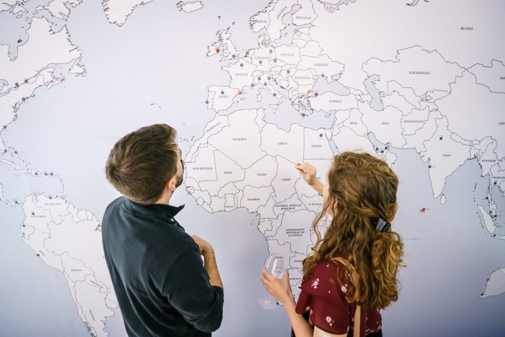 Guests at the Bonvoy event put on by Crush Studio place pins on a map of where in the world they want to go.