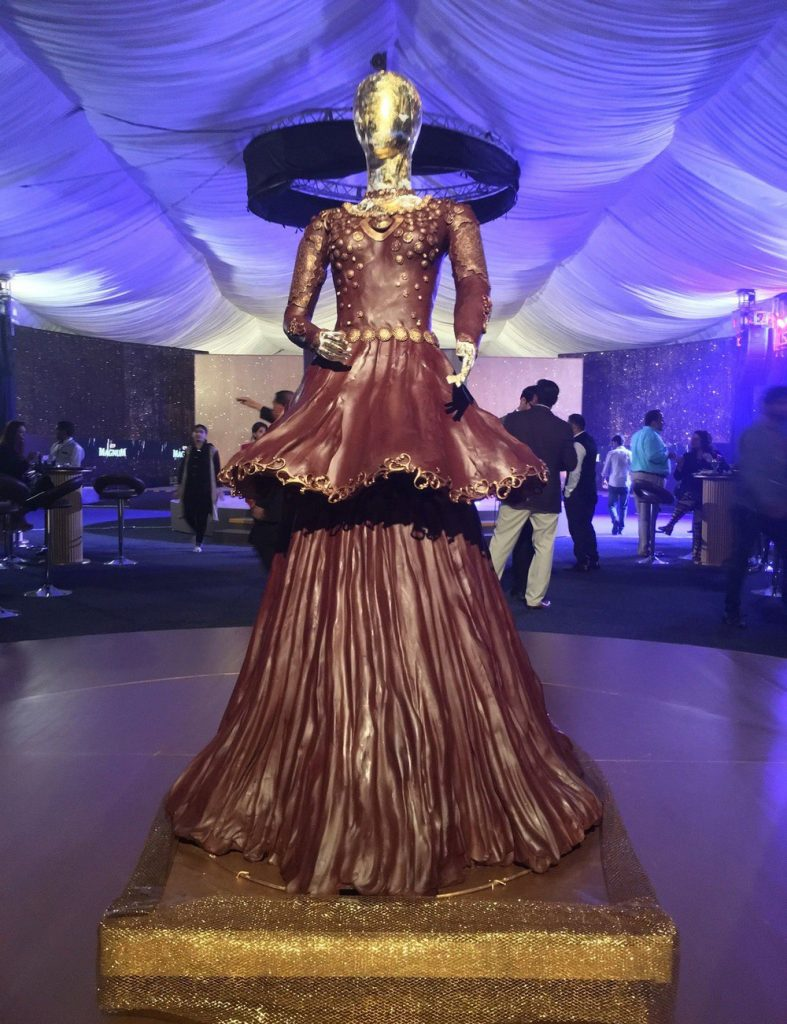 Magnum Ice Cream had carving artist Paul Joachim create chocolate sculpture of a dress.