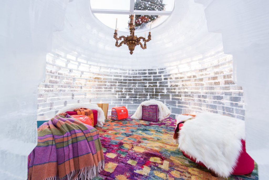 Beautiful furnishings and a chandelier inside an igloo at City Center DC.