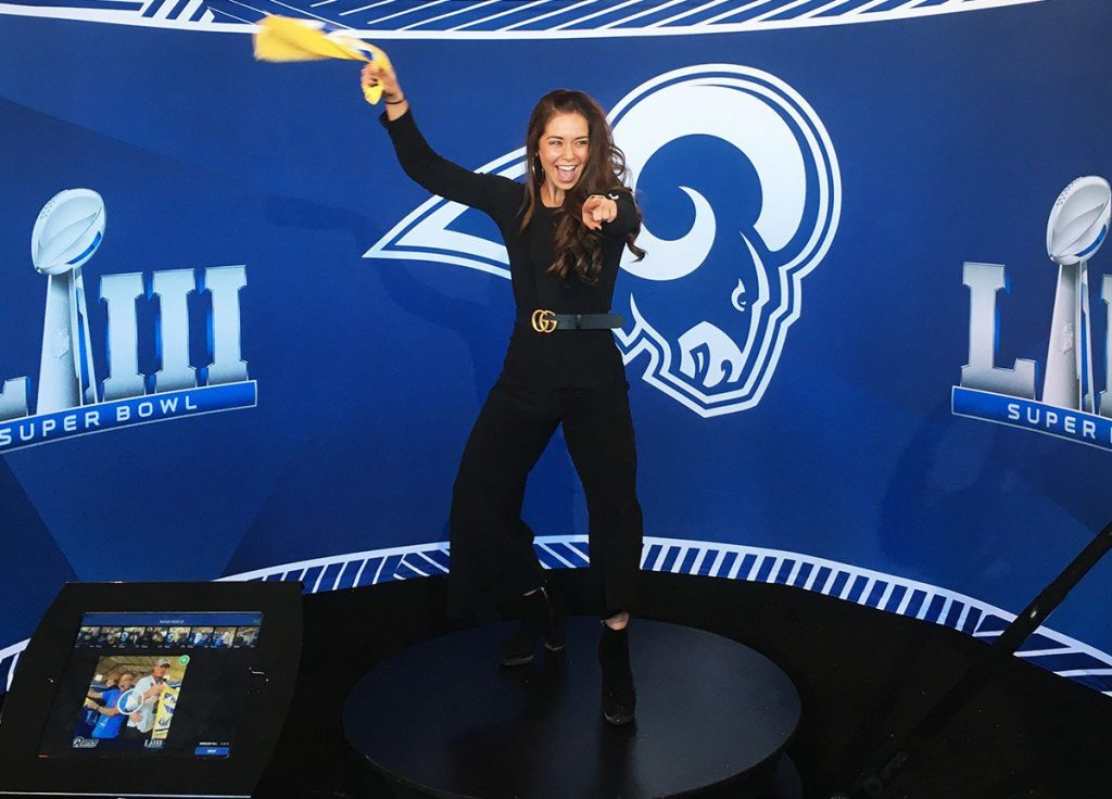 Guest poses for 360 photo booth built by OrcaVue at Super Bowl LIII.