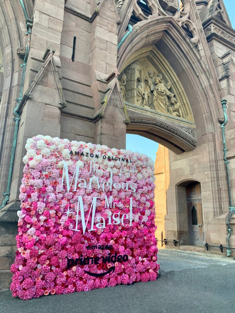 A perfectly pink ombré flower wall turned heads at an outdoor screening of Amazon Prime Video's hit series The Marvelous Mrs. Maisel at Green-Wood Cemetery.