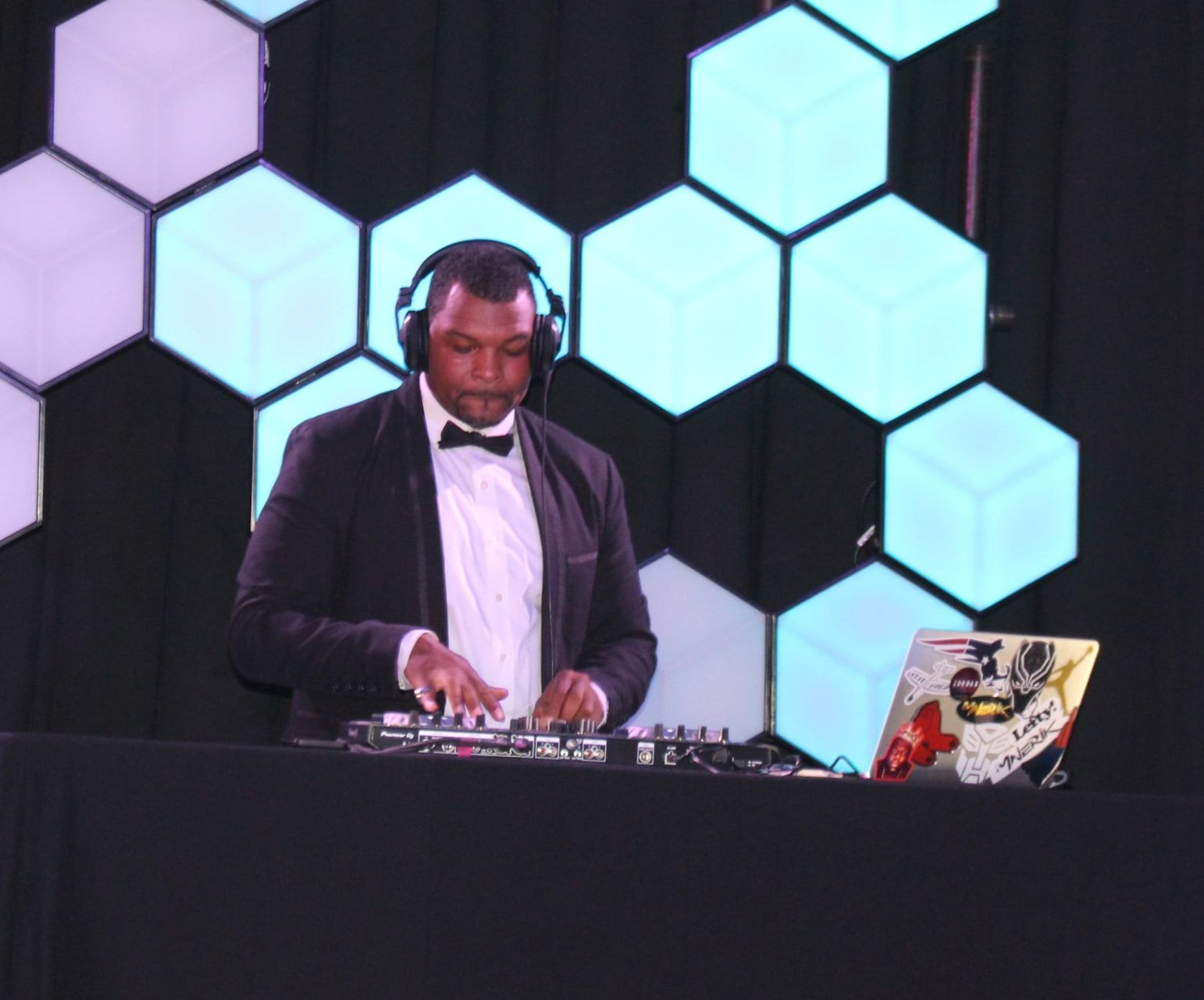 DJ in a tux at a fundraising event