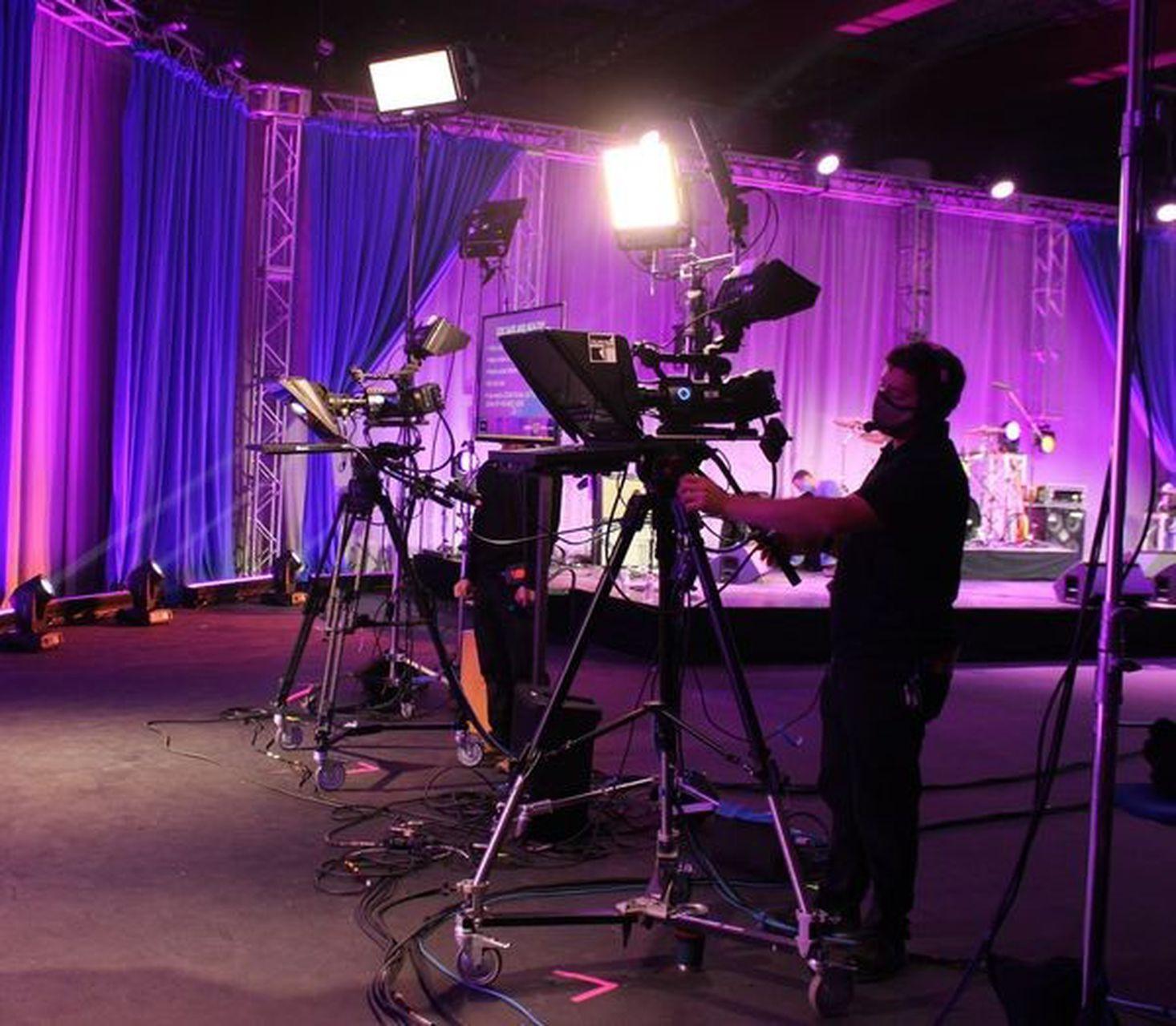 Camera crew filming a fundraising event