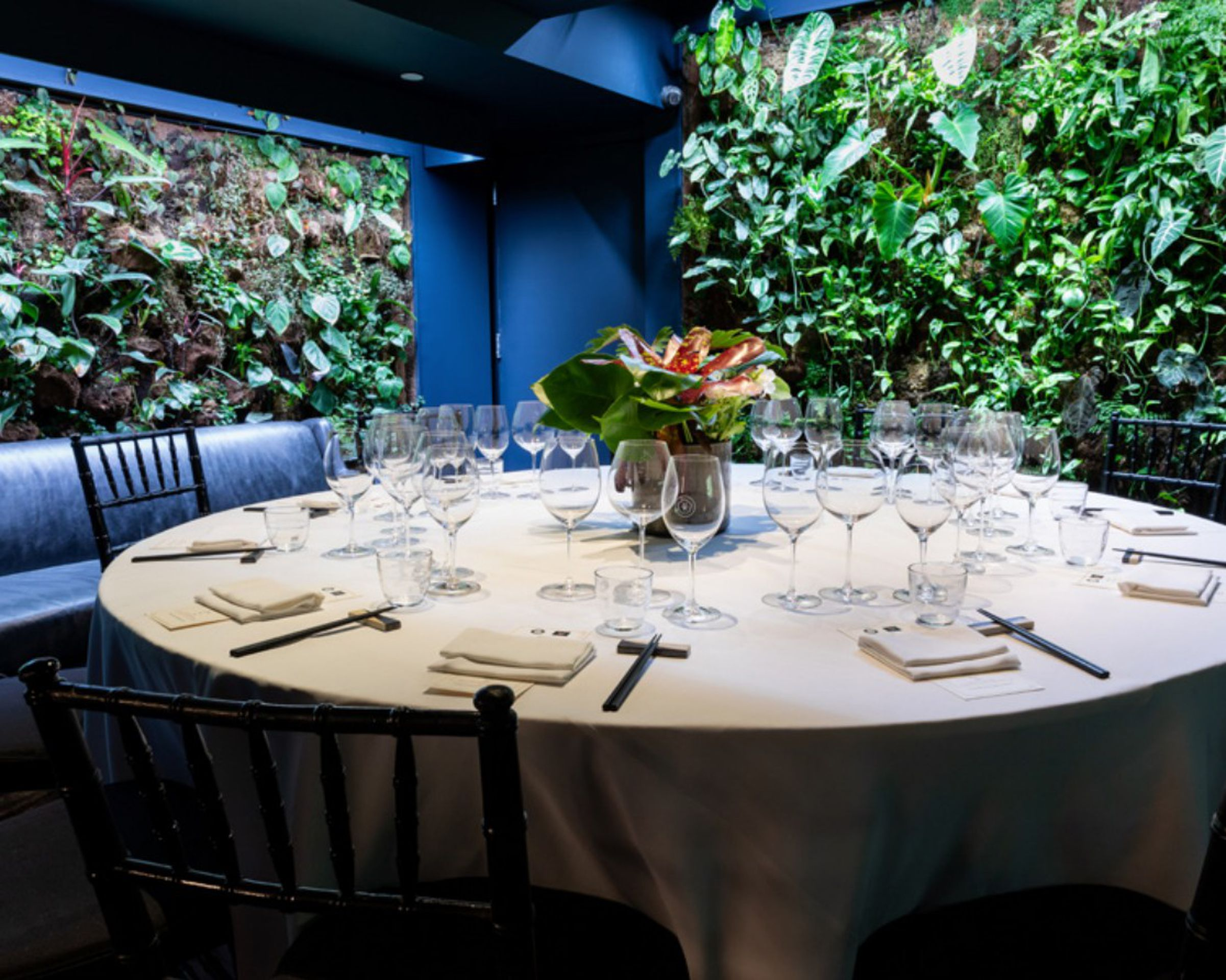 Round table next to greenery wall