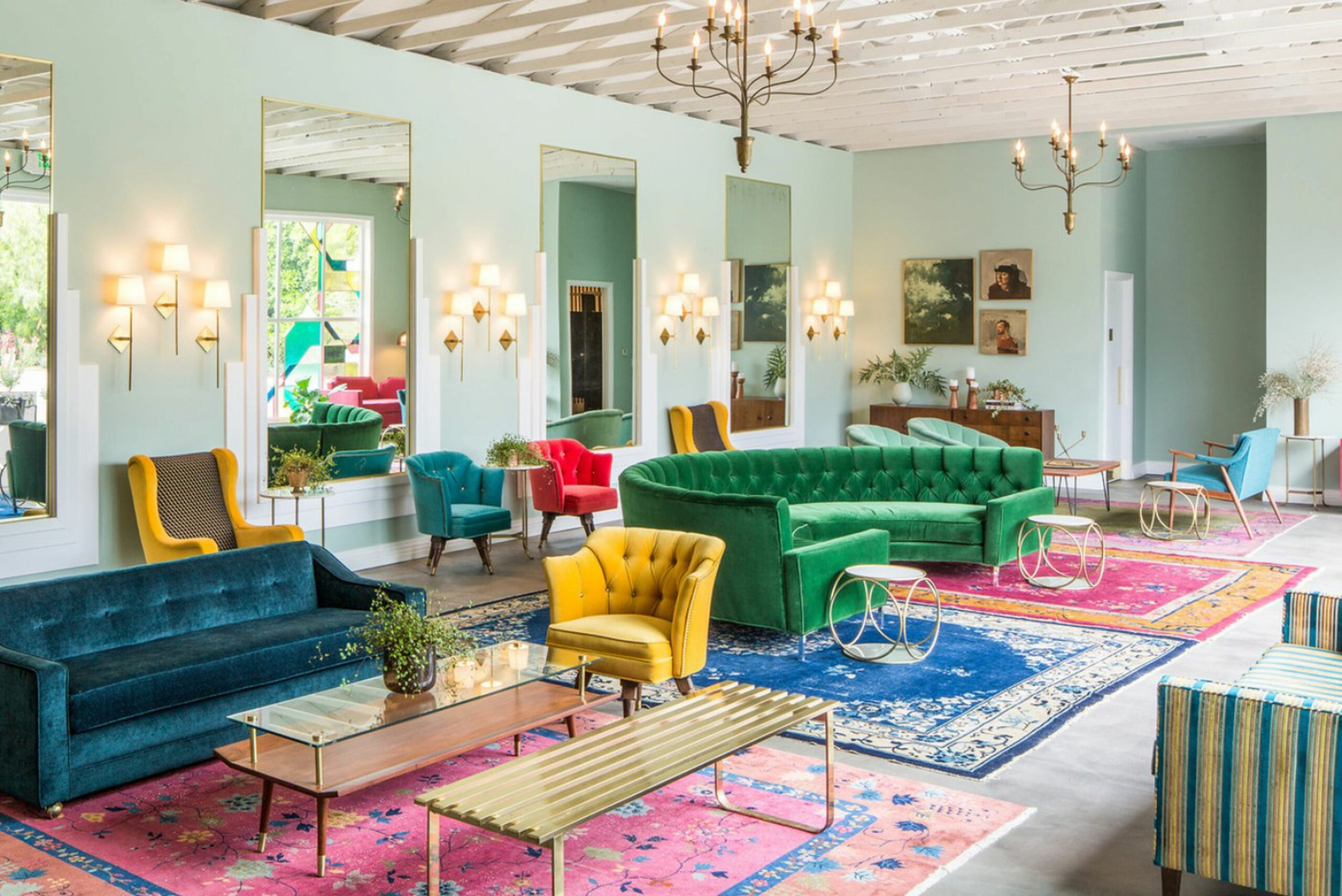 Bright space with colorful velvet ouches and eclectic chairs
